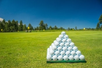 The Best Golf Balls for High Handicappers piled up in a pyramid