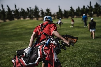 person carrying the best sunday golf bag