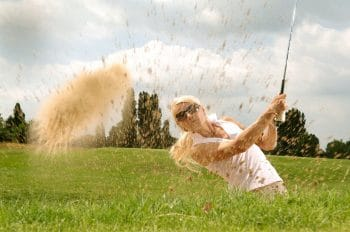 Lady using the best womens golf clubs