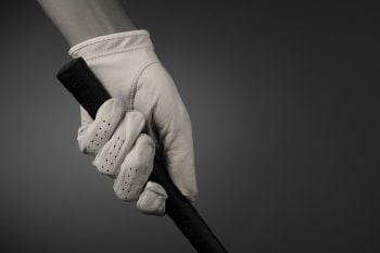 Golf Club Grip being held with gloves