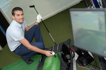 Man with Golf Simulator